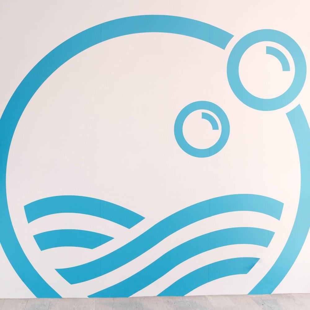 Logo su Muro Lavanderia Sabrina Fivesix Studio Agenzia di comunicazione Vicenza
